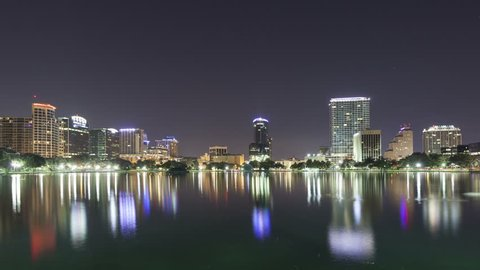 ORLANDO, FLORIDA, USA - OCT 30, 2014: 4K Time lapse zoom out of the twilight morning sun rising on the skyline of Orlando at lake Eola