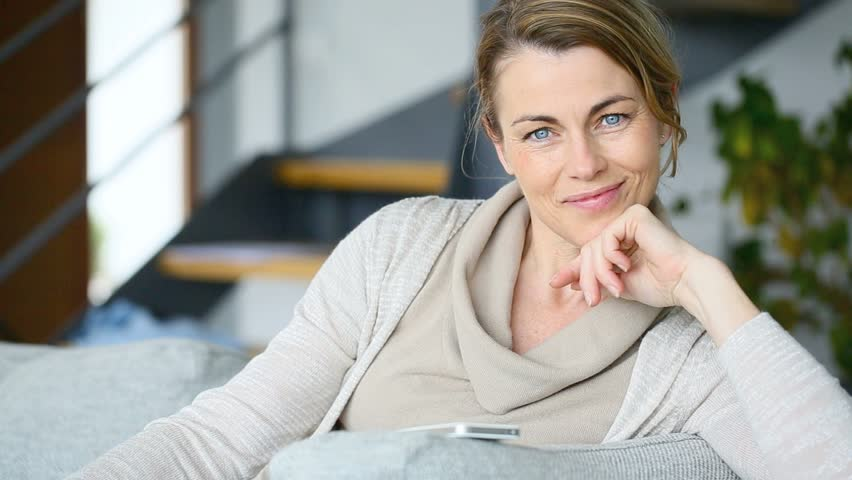 Mature Woman Relaxing At Home Sitting On Couch Stock Footage Video 9572162  Shutterstock-7001