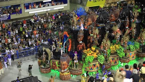 RIO DE JANEIRO, BRAZIl - FEBRUARY 16, 2015: Participants in the Carnival from Samba school Bejja-Flor present their costumes during the Carnival, February 16, 2015 in Rio de Janeiro (Brazil)
