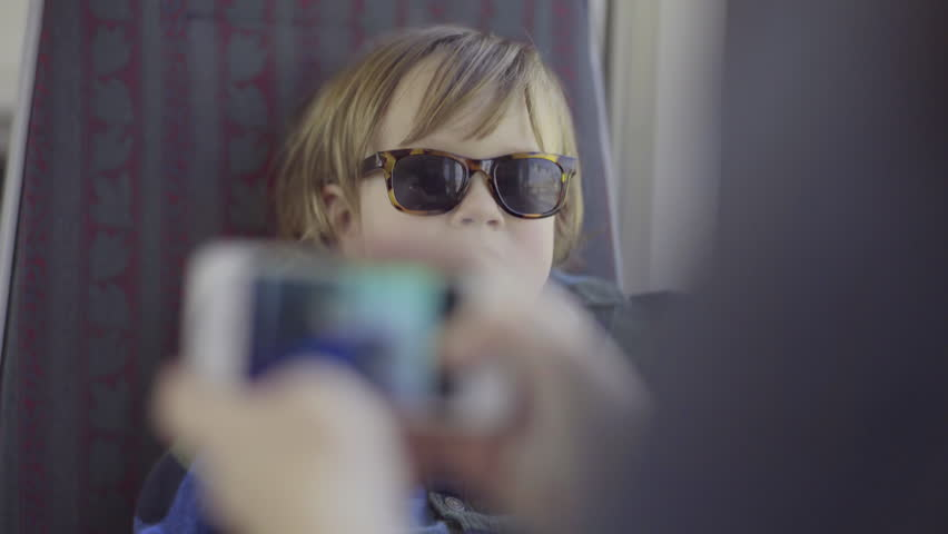 Mother Takes A Photo Of Her Son Riding A Train (4k) | Shutterstock HD Video #9602333