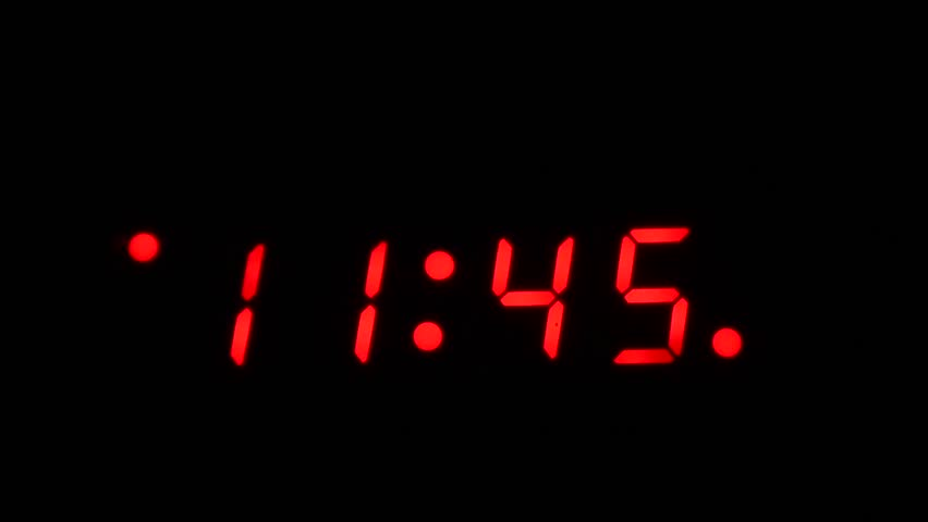 Time lapse of a digital clock approaching midnight