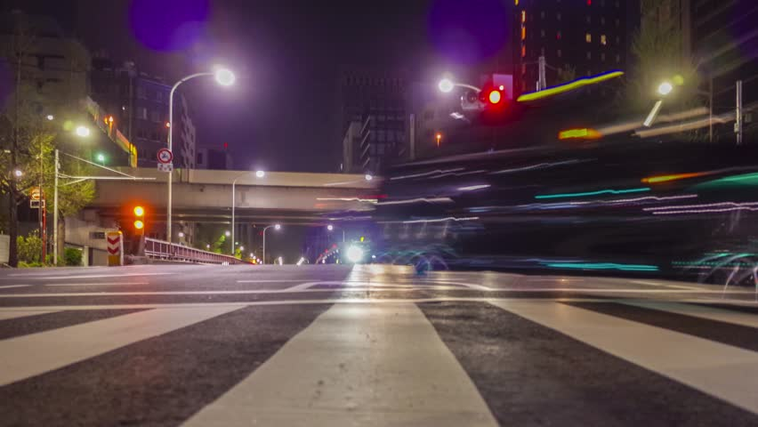 4K timelapse footage - Cars move leave long traces of road in Tokyo Ginza aria, Japan. | Shutterstock HD Video #9640133