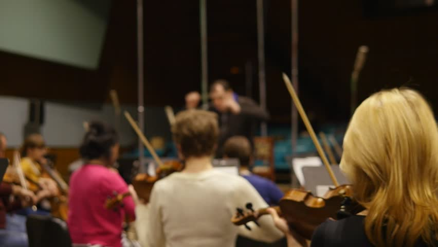 Conductor and orchestra on rehearsal. Working in sound studio | Shutterstock HD Video #9673373