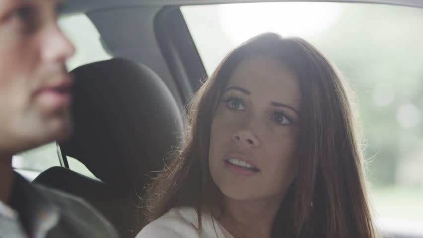 4K Unhappy couple arguing in car