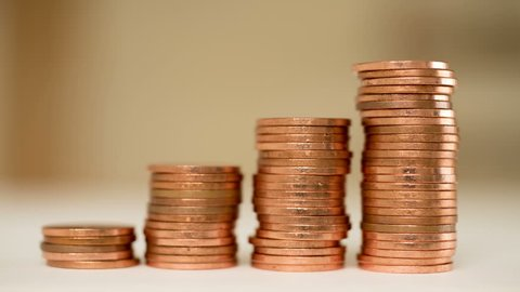 Rising columns of coins.