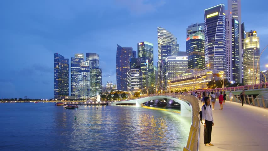 SINGAPORE - CIRCA APRIL 2015: City skyline, Marina Bay and Raffles Place, view at night, time-lapse in motion, hyperlapse.