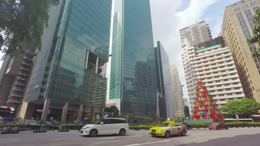 SINGAPORE - CIRCA APRIL 2015: Business district Raffles Place, time-lapse in motion, hyperlapse.