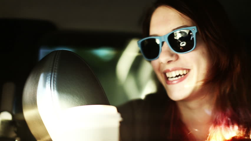 82b5ebf48a5 Smiling lifestyle portrait of laughing woman in sunglasses inside a car joy  ride