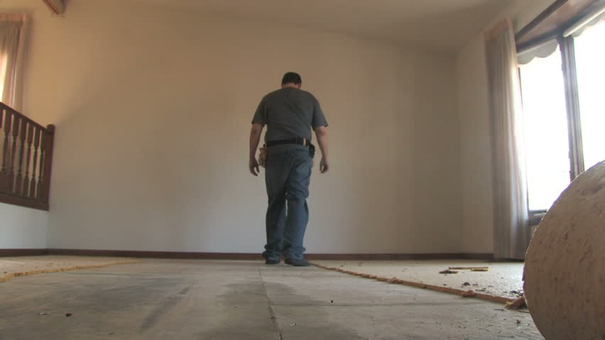 Man Removing Carpet