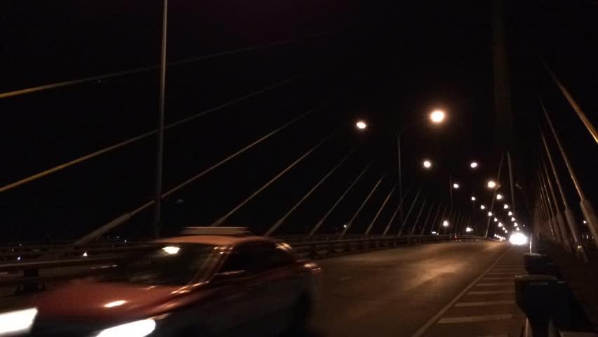 Timelapse of cars moving on night city bridge | Shutterstock HD Video #9831863