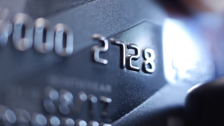 Credit Card swipe through PIN Terminal. Extreme closeup. Shallow depth of field