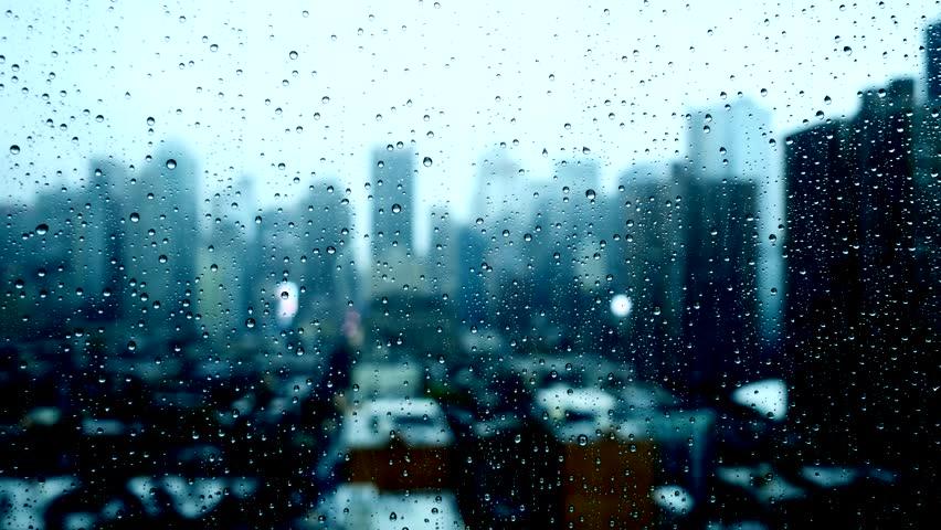 Blurry Urban City Background. Rain Drops On Window Glass. Rainy ...