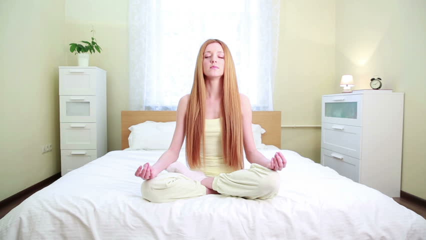 Young charming woman sitting in the lotus position and meditates on the bed  in the bedroom. Black Girl Dancing In Bedroom Stock Footage Video 4432370