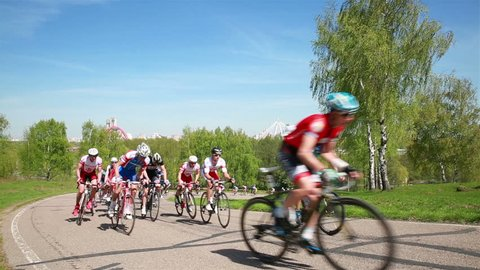 MOSCOW, RUSSIA - APRIL 08, 2015: Bicycle Race. A group of cyclists on a high speed drive up a hill. International competitions in road cycling.