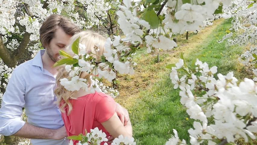 Happy couple having fun in garden - slow motion | Shutterstock HD Video #9934940