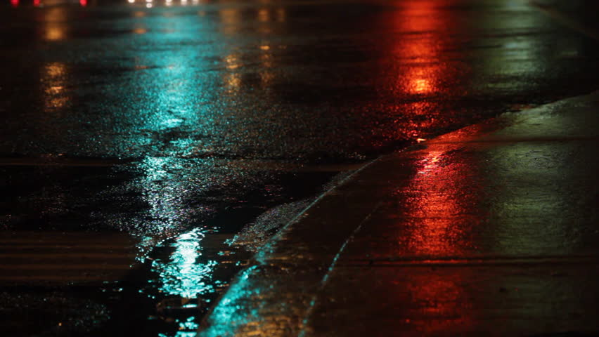 Rainy night. Traffic lights green, amber, red. Rainy night in the city. Reflection of traffic lights changing from green to amber to red. Sound of traffic. Shallow DOF. Toronto, Ontario, Canada.