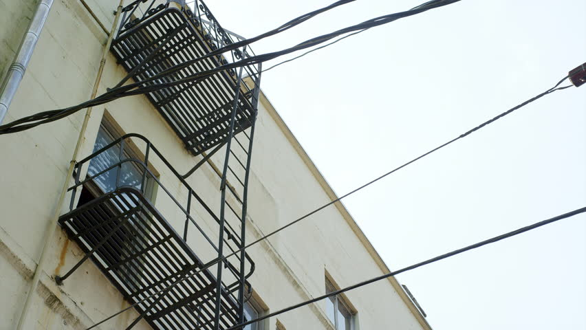 Establishing Shot Of An Apartment Building With Fire Escapes   4K Stock  Footage Clip