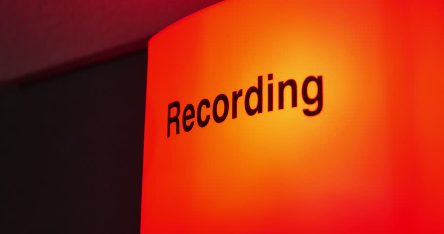 Close up shot of a recording sign being turned on