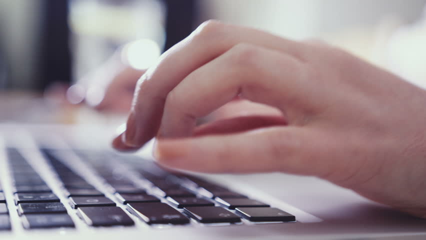 Closeup of business woman hand typing on laptop keyboard. Closeup of a female hands busy typing on a laptop. Woman's hands pressing keys on a laptop keyboard trying to access data. | Shutterstock HD Video #9981668